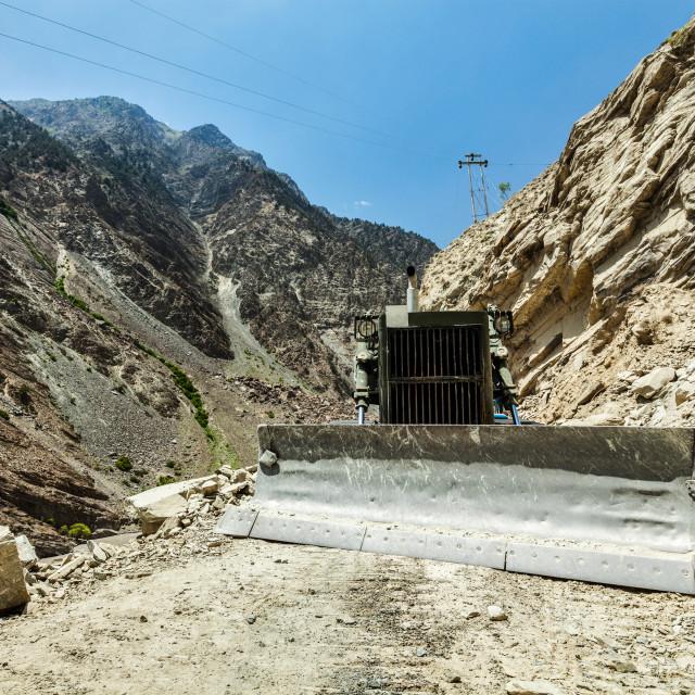 """Bulldozer doing road construction in Himalayas"" stock image"