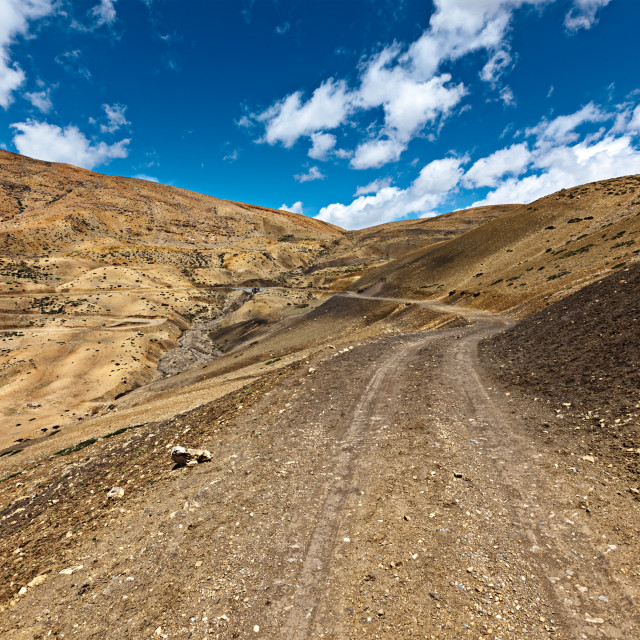 """Dirt road in mountains (Himalayas). Spiti Valley, Himachal Pradesh, India"" stock image"