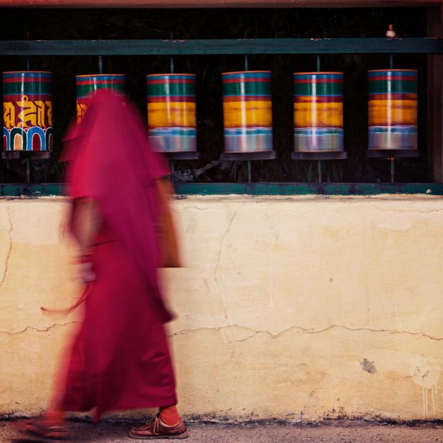"""Buddhist monk spinning prayer wheels. McLeod Ganj"" stock image"