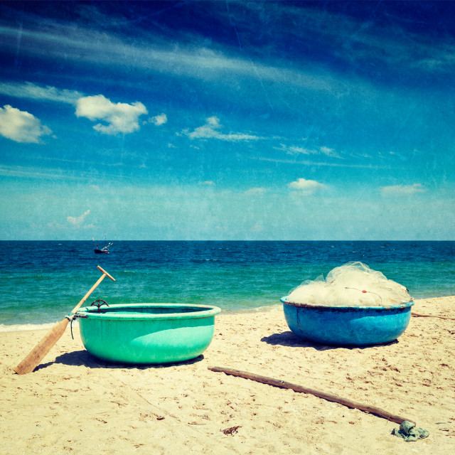 """""""Vintage retro hipster style travel image of fishing coracle boats on beach with grunge texture overlaid. Mui Ne, Vietnam"""" stock image"""