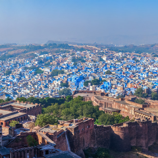 """""""Aerial panorama of Jodhpur, also known as """"Blue City"""" due to the vivid blue-painted Brahmin houses. View from Mehrangarh Fort (part of fortifications is also visible). Jodphur, Rajasthan, India"""" stock image"""