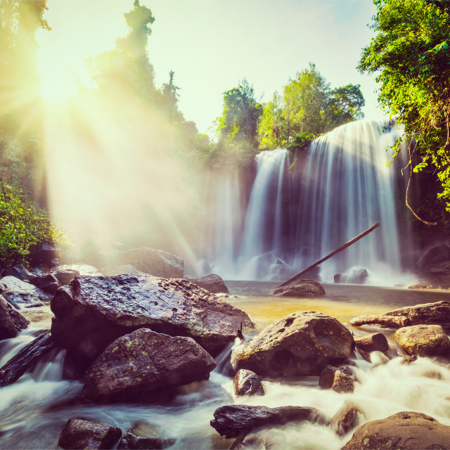"""""""Vintage retro effect filtered hipster style image of tropical waterfall with sun rays in Cambodia"""" stock image"""