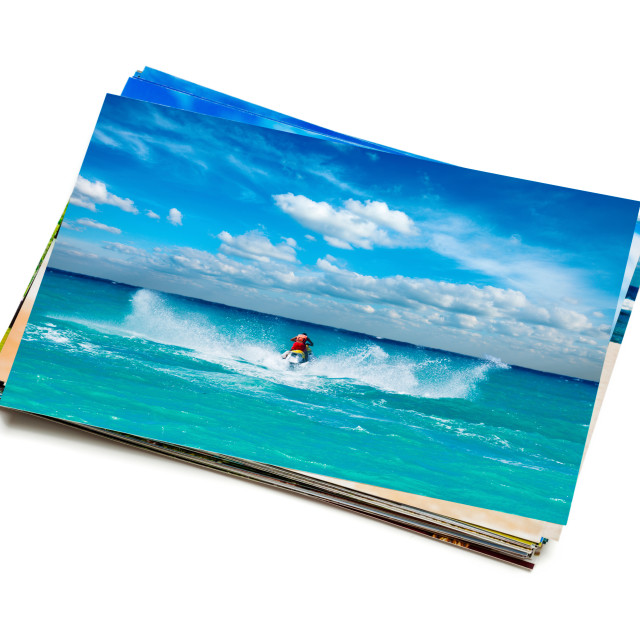 """Stack of vacation photos isolated"" stock image"