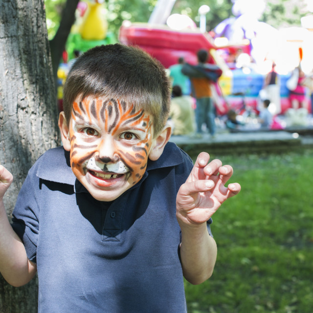 """Child with painted face"" stock image"