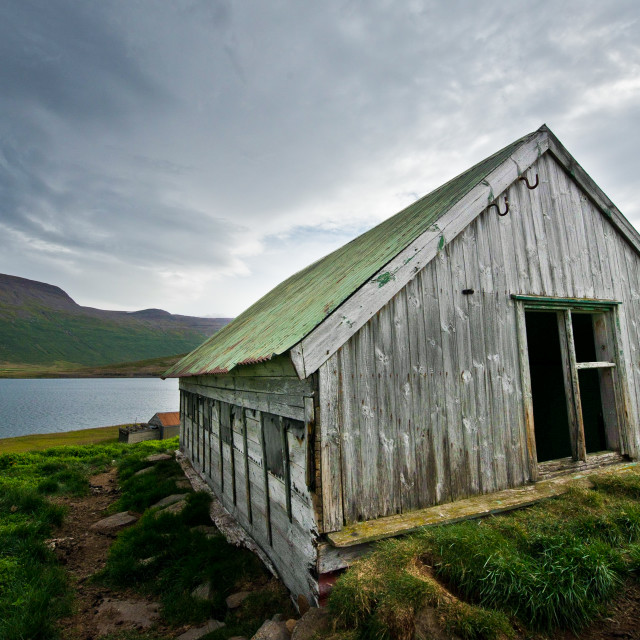 """Weathered sheep shed"" stock image"