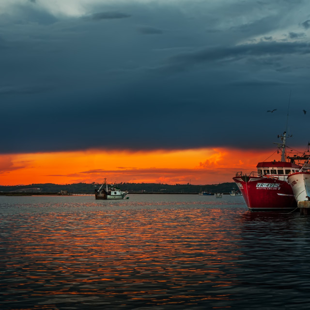 """fishing boats at sunset"" stock image"