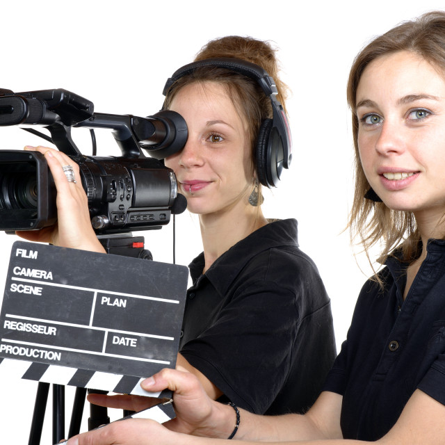 """""""two young women with a video camera"""" stock image"""