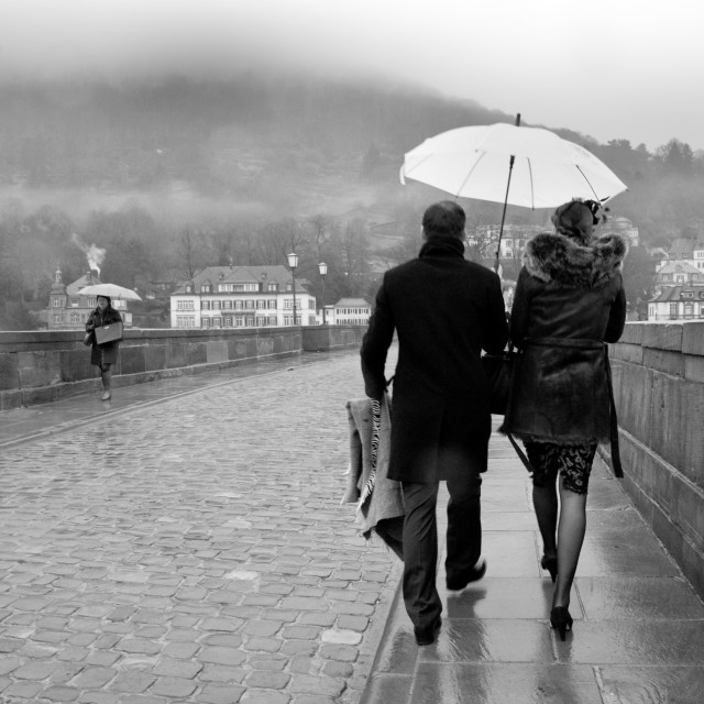 """Couple On A Rainy Day Under An Umbrella"" stock image"