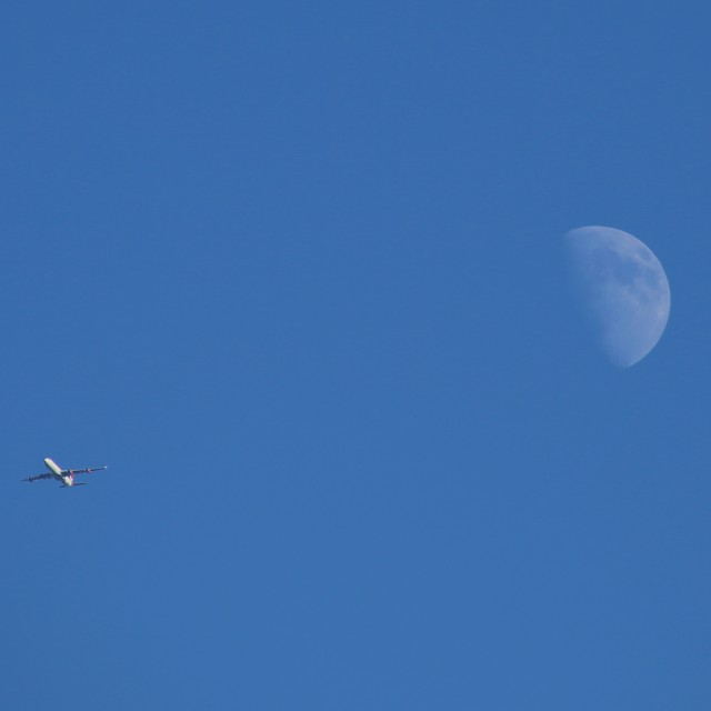 """A340 Airbus Passing the Moon"" stock image"