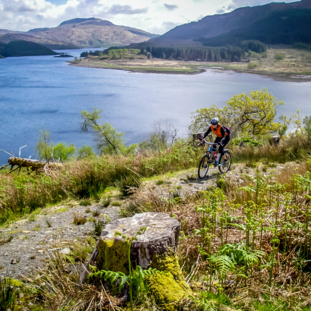 """Mountain Biking Loch Morar"" stock image"