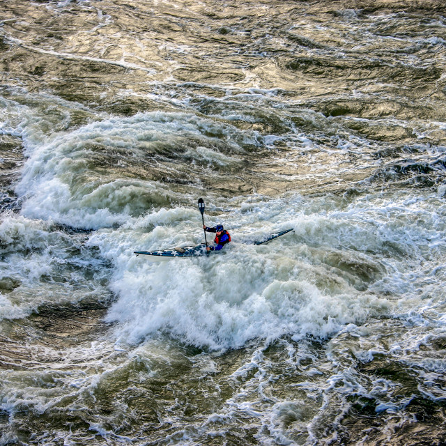 """Sea kayak in rough water"" stock image"