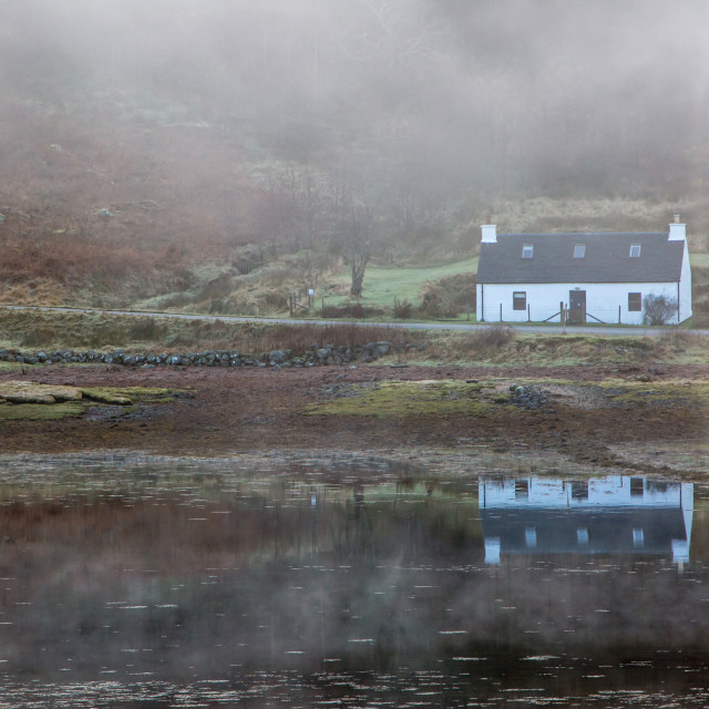 """Holiday rental cottage by loch"" stock image"