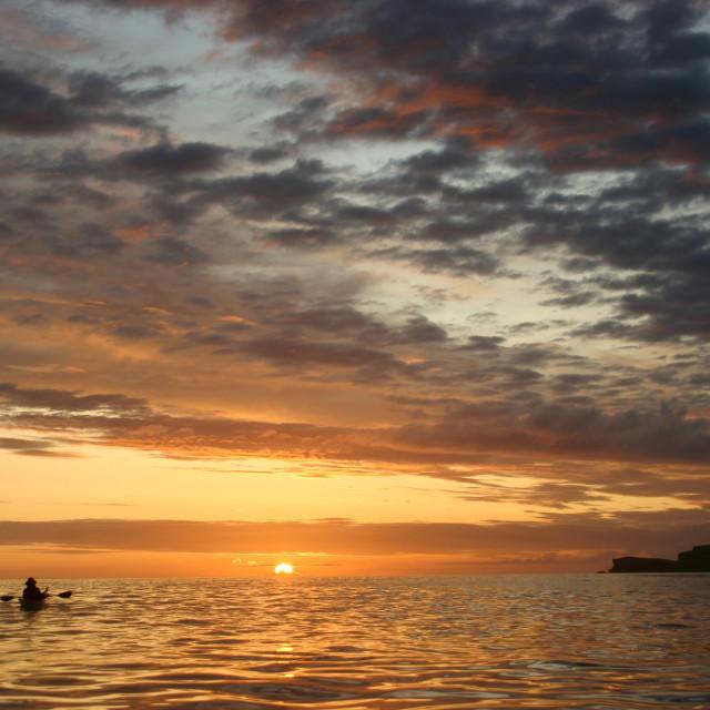 """Sea kayak sunset"" stock image"