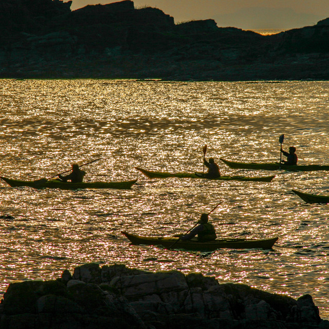 """Sea kayak group silhouette"" stock image"