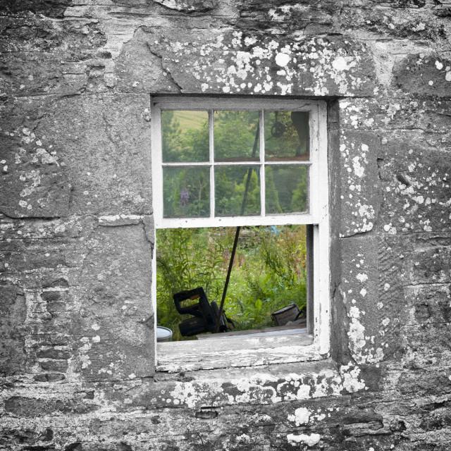 """""""A colour view through a black & white window"""" stock image"""