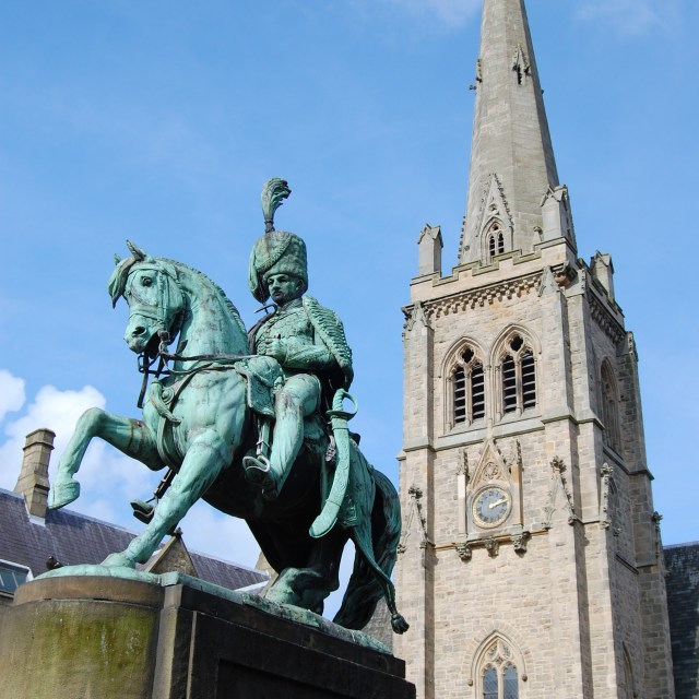 """St Nicholas Church and Equestrian Statue"" stock image"