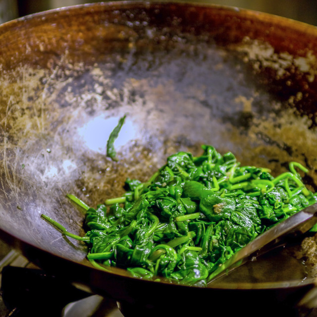 """Stirfryed spinach in wok"" stock image"