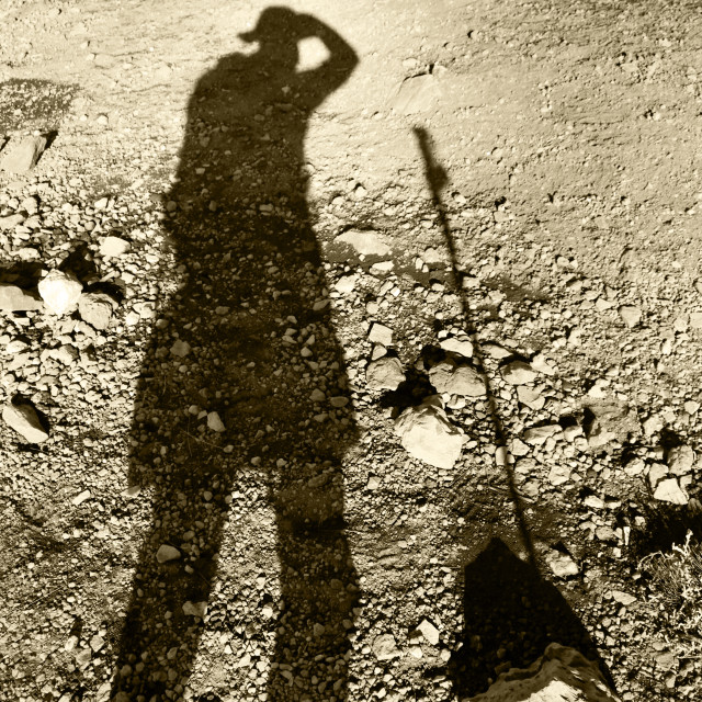 """Trekkers shadow on the scree and gravel of Mt Kilimanjaro"" stock image"