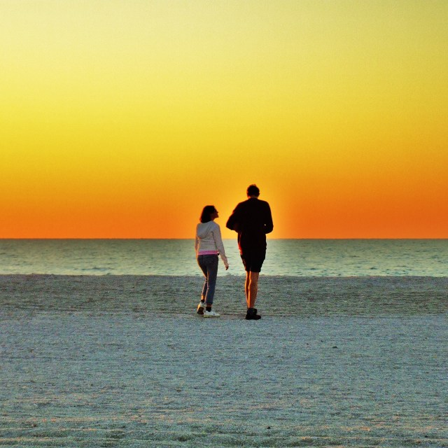 """Walks on a beach"" stock image"