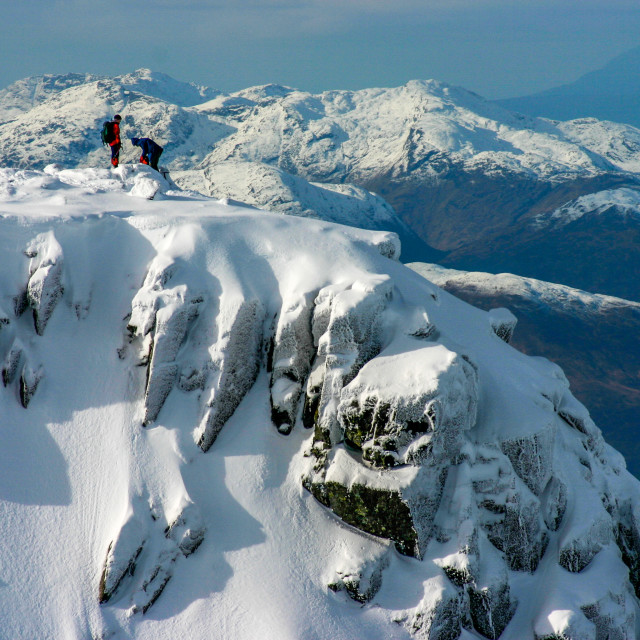 """Climbers top out Tower Ridge, Ben Nevis in Winter"" stock image"