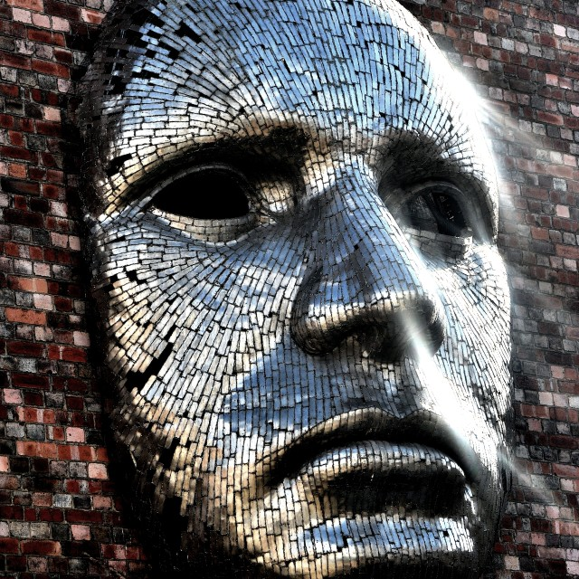 """Giant Metal Face"" stock image"