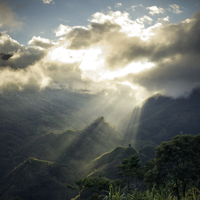 """Sunlight behind clouds, Guatemala"" stock image"