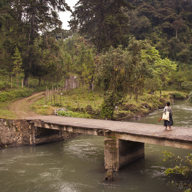 """Woman crossing swollen river, Guatemala"" stock image"