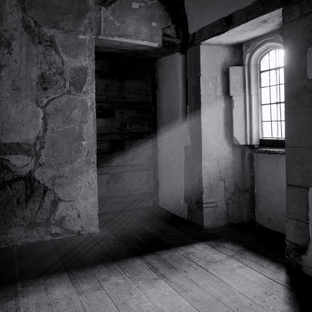 """Sunlight streaming through a window of Fiddleford Manor, Dorset, UK"" stock image"
