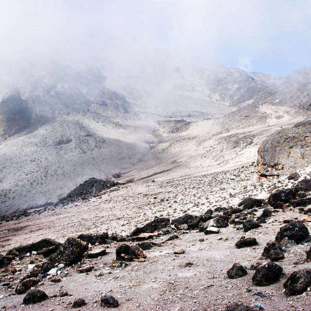 """Alpine desert shrouded in cloud"" stock image"