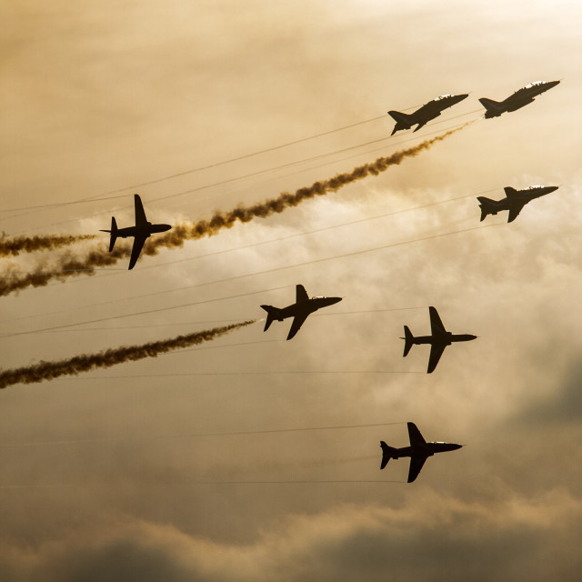 """Red Arrows at Sunset"" stock image"