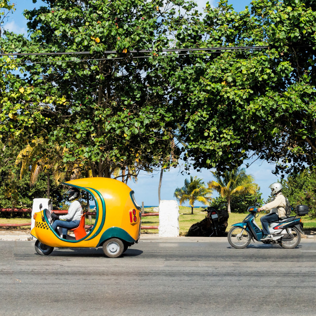 """Coco-taxi and a scooter"" stock image"