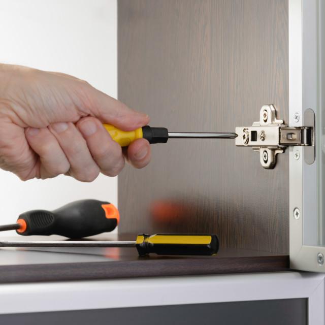 """""""Adjusting a Concealed Hinge"""" stock image"""