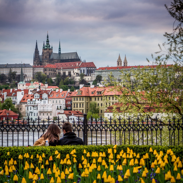 """A couple over the river from Prague Castle"" stock image"