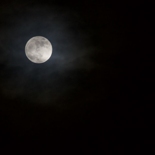 """Full moon through clouds"" stock image"