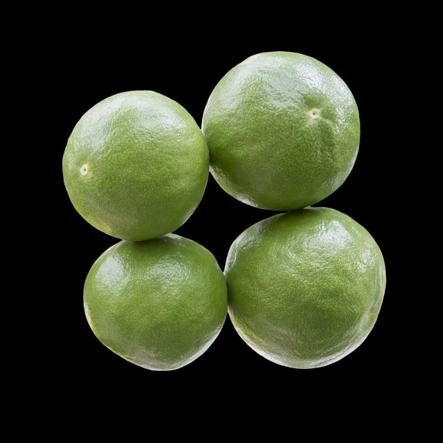 """Four lime fruits"" stock image"