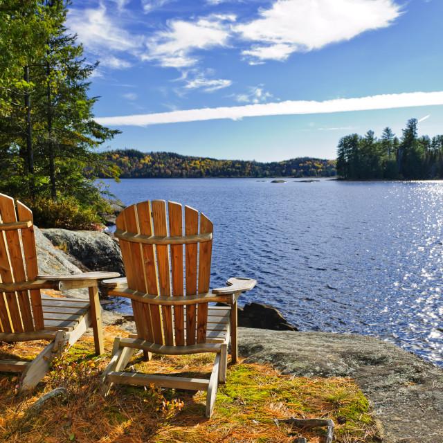 """""""Adirondack chairs at lake shore"""" stock image"""