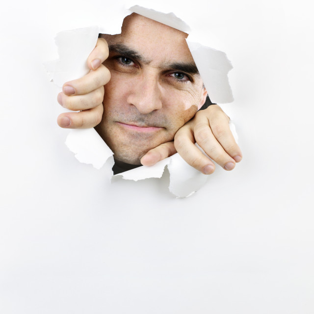 """""""Face looking through hole in paper"""" stock image"""