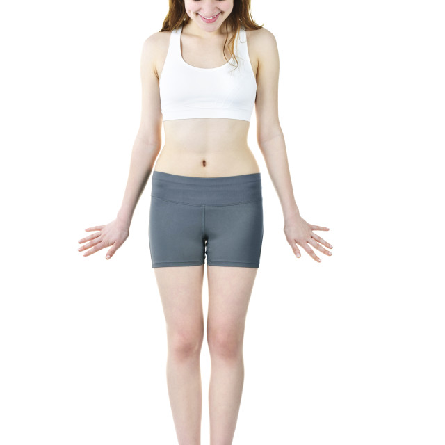 """""""Fit young girl checking her weight"""" stock image"""