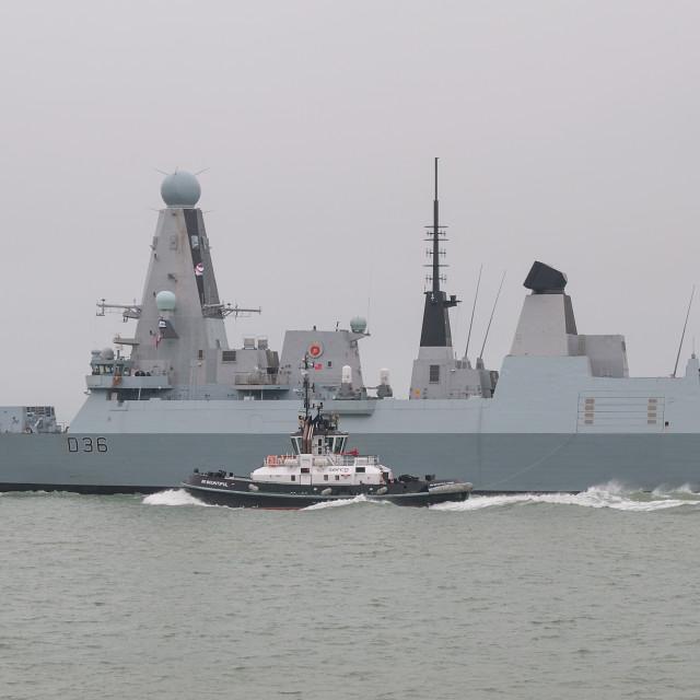 """""""Tug versus Type 45"""" stock image"""