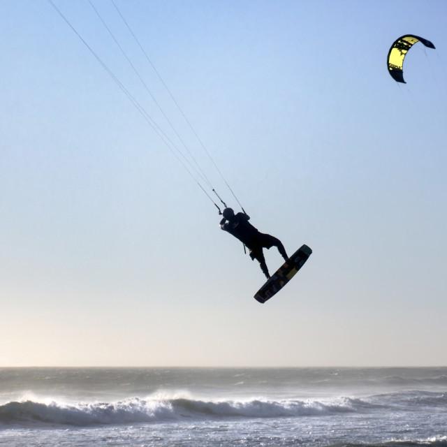 """Mid-air Kite Surfer's Acrobatics"" stock image"
