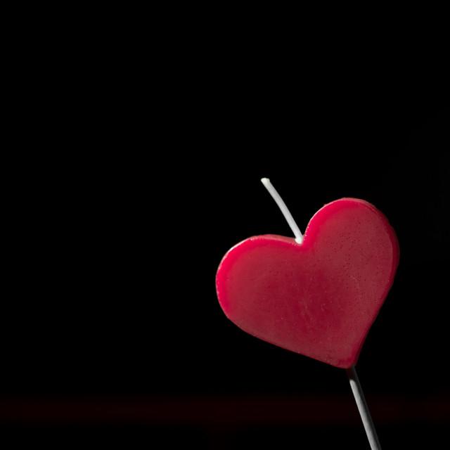 """Heart shaped candle. Black background"" stock image"
