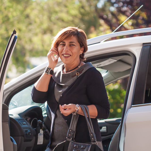 """""""beautiful modern businesswoman out of the car"""" stock image"""