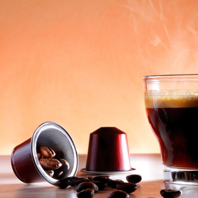 """""""Capsules and cup of hot espresso coffee close up"""" stock image"""