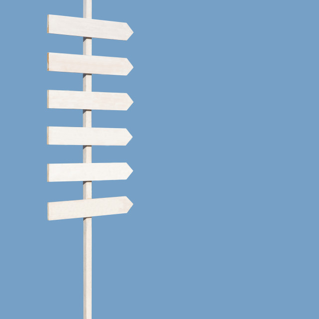 """""""Rustic sign post with six arrows on blue"""" stock image"""