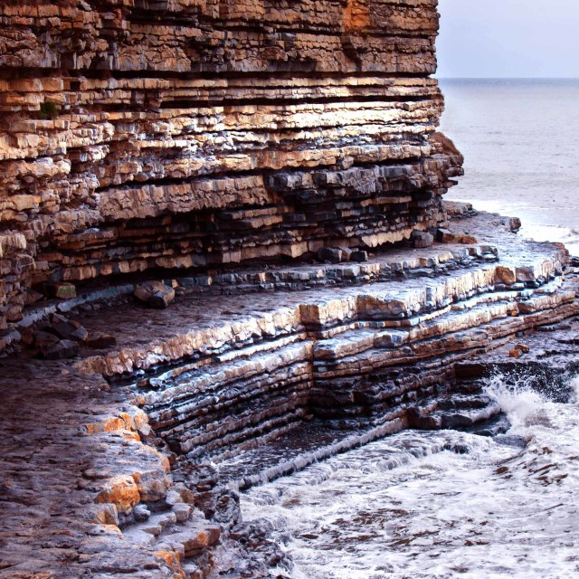 """Coastal erosion of cliffs and rocks at the south Wales coast"" stock image"