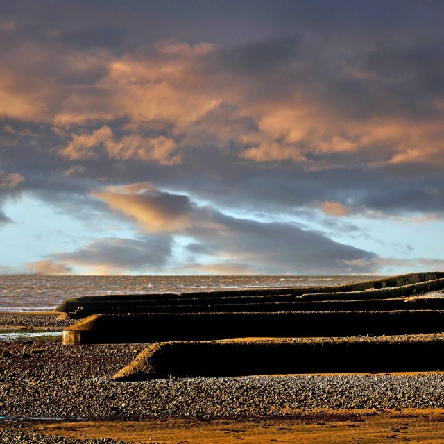 """""""Sun setting over the Bristol Channel looking from Aberthaw Villa"""" stock image"""