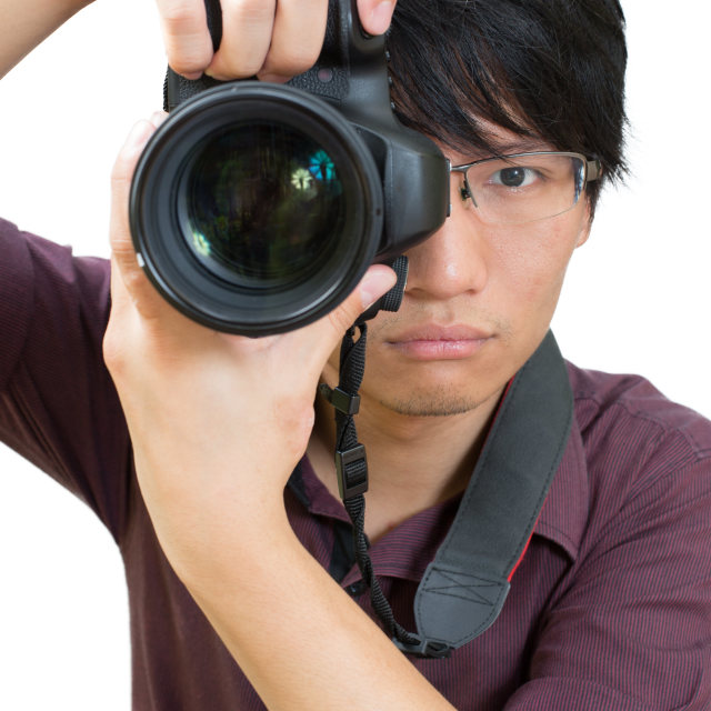 """""""Asian man taking a picture with dslr"""" stock image"""