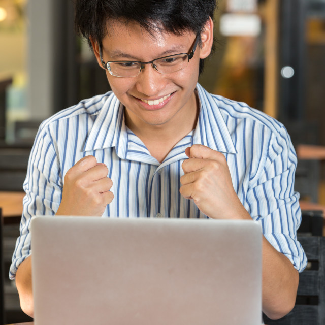 """""""Asian person using a personal computer"""" stock image"""