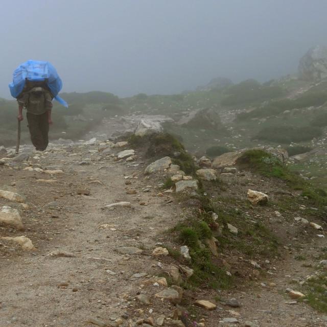 """Porter in Monsoon Mist Nepal"" stock image"
