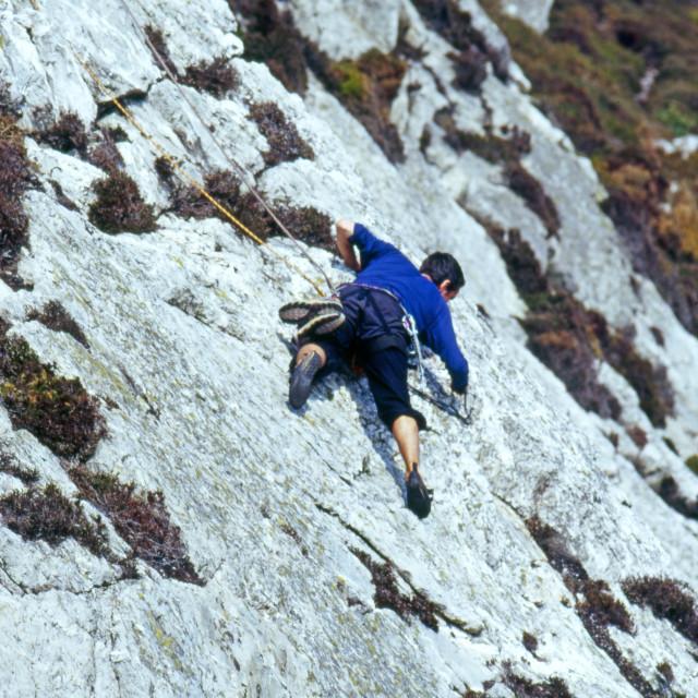 """Climber on rock face"" stock image"